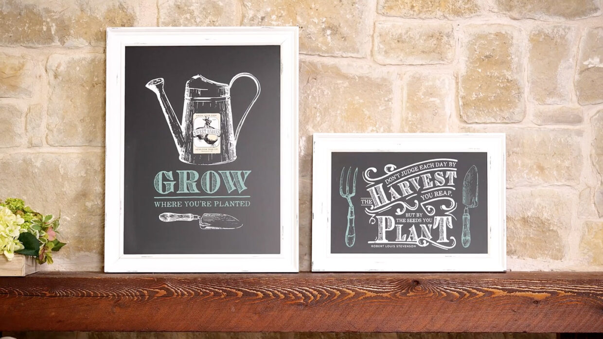 Chalk Couture Lifestyle Image of farm style designs on chalkboards leaning on large wooden mantel